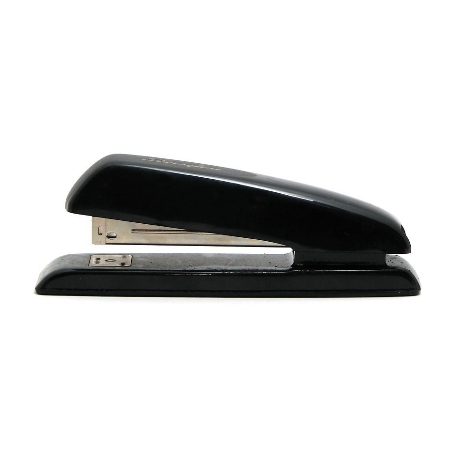 A black stapler isolated on a white background : Free Stock Photo