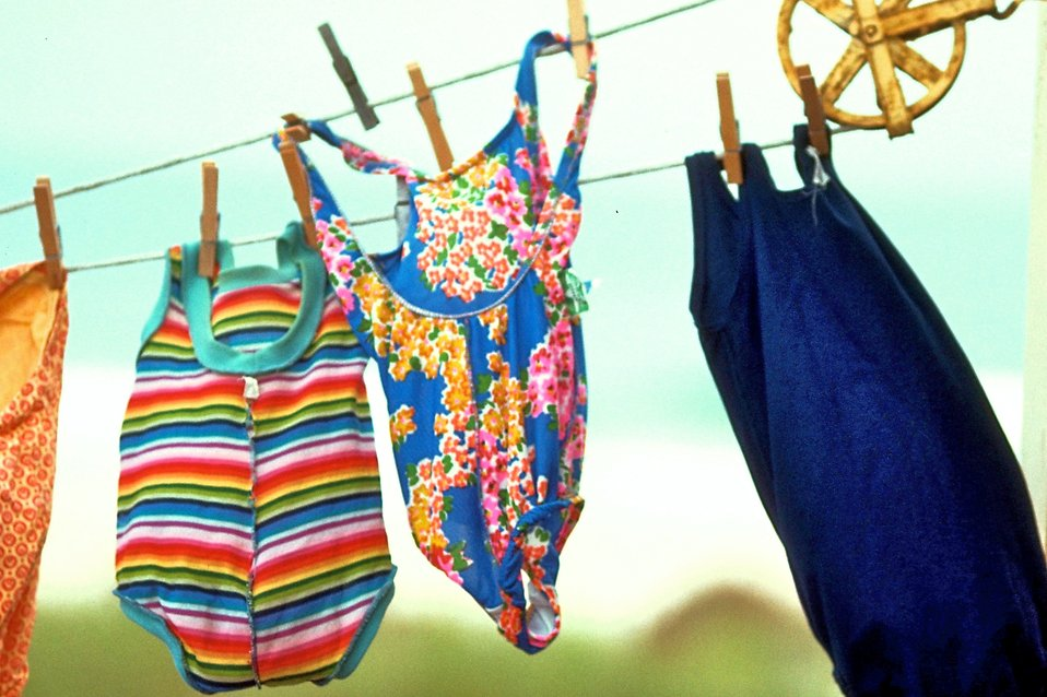 Colorful swimsuits drying on a clothesline : Free Stock Photo