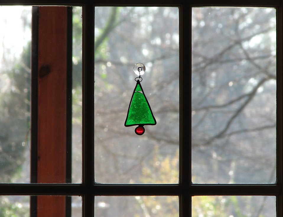 A Christmas tree decoration on a window : Free Stock Photo