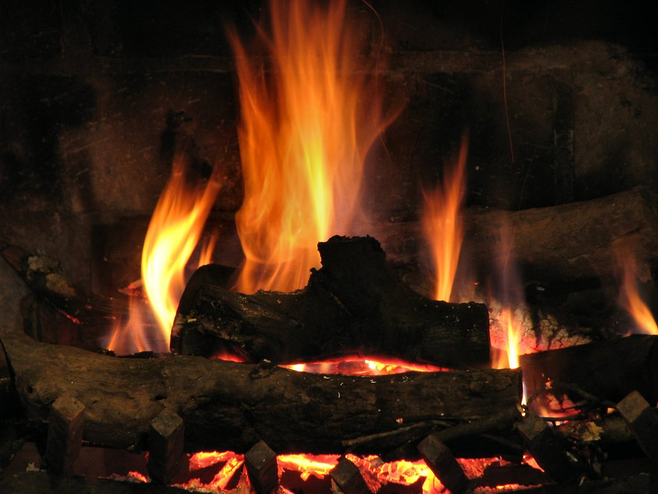 Close-up of a fire burning in a fireplace : Free Stock Photo