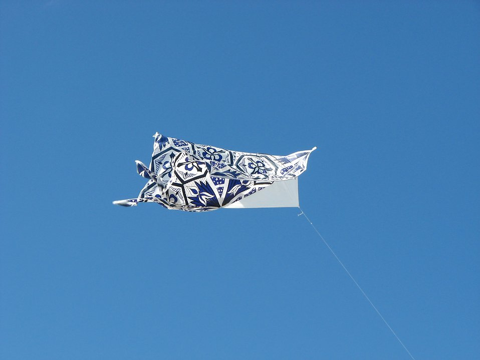 A blue kite in the sky : Free Stock Photo