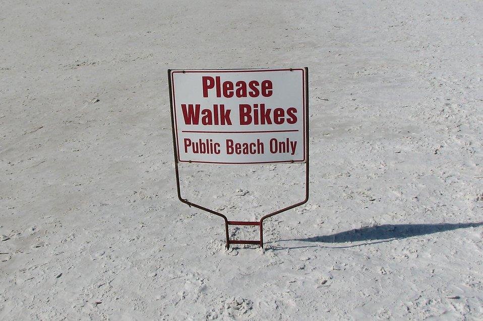 A bike sign on the beach : Free Stock Photo