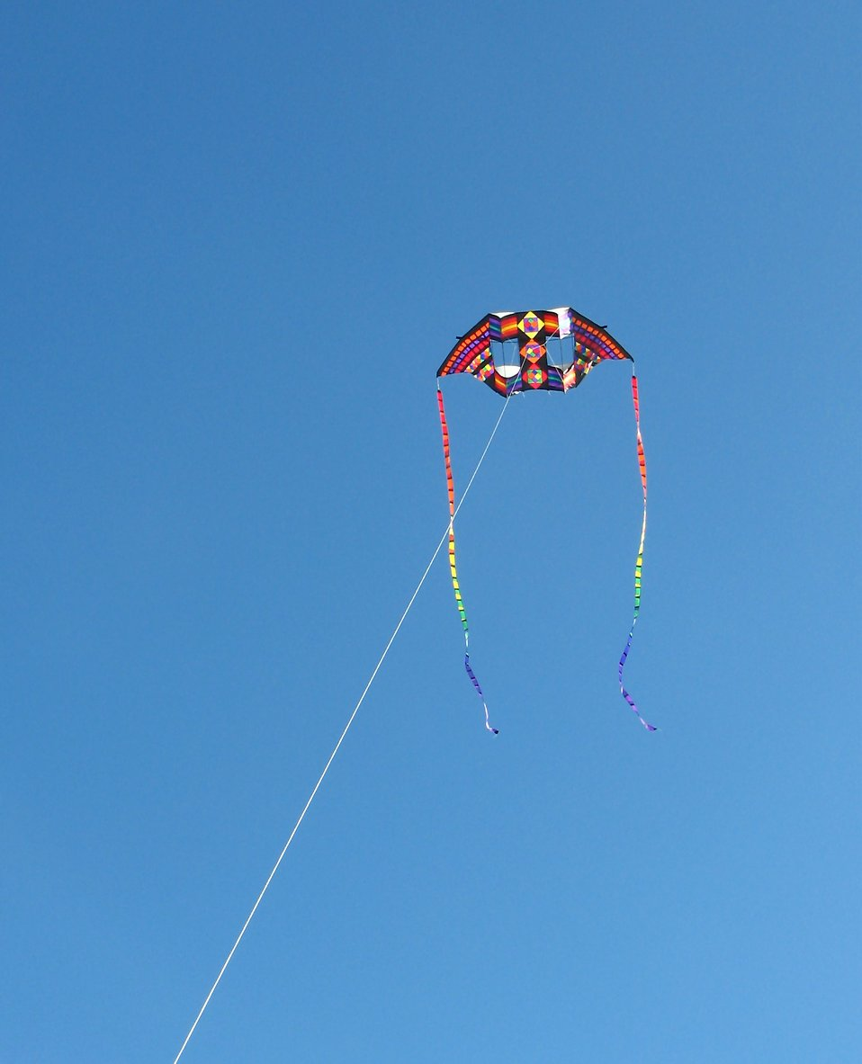 A colorful kite in the sky : Free Stock Photo