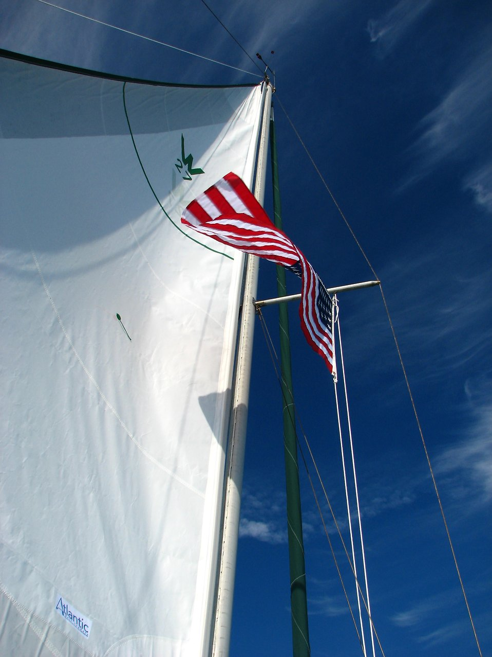 An American flag and a sail on a sailboat : Free Stock Photo