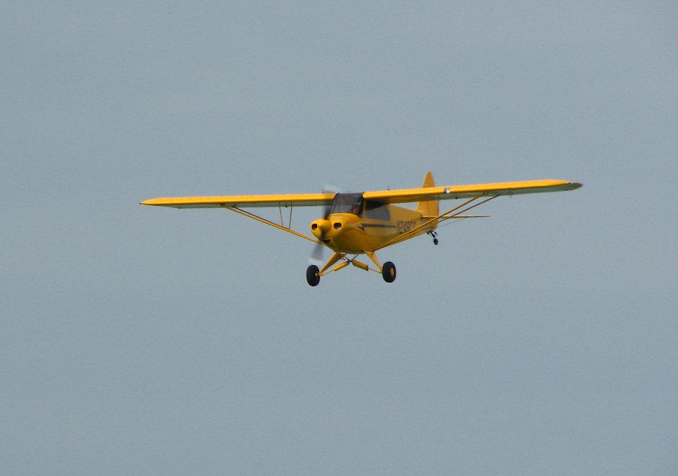 A yellow airplane : Free Stock Photo