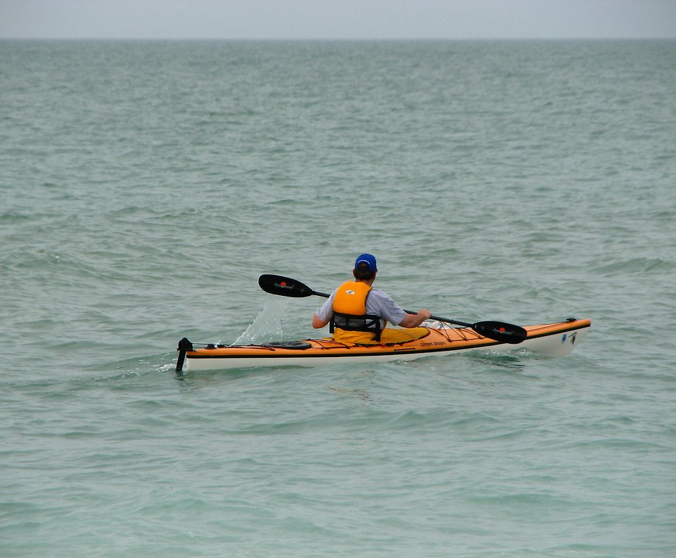 A man in a kayak in the ocean : Free Stock Photo