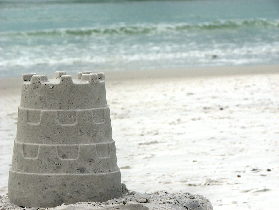 A sandcastle overlooking the ocean.