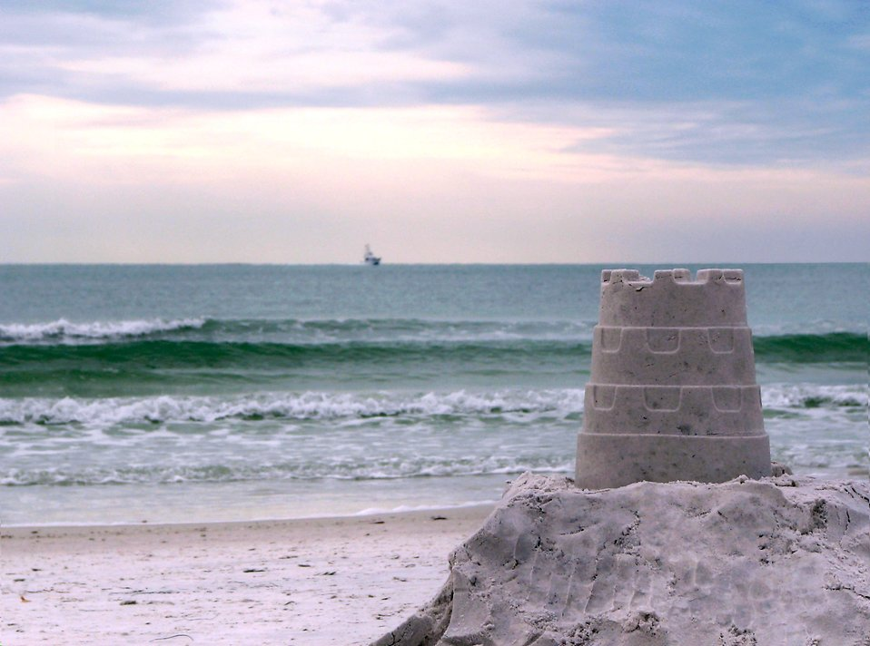 A sandcastle overlooking the ocean : Free Stock Photo