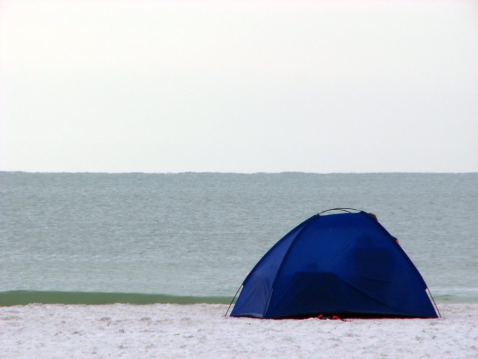 A blue tent on the beach by the ocean : Free Stock Photo