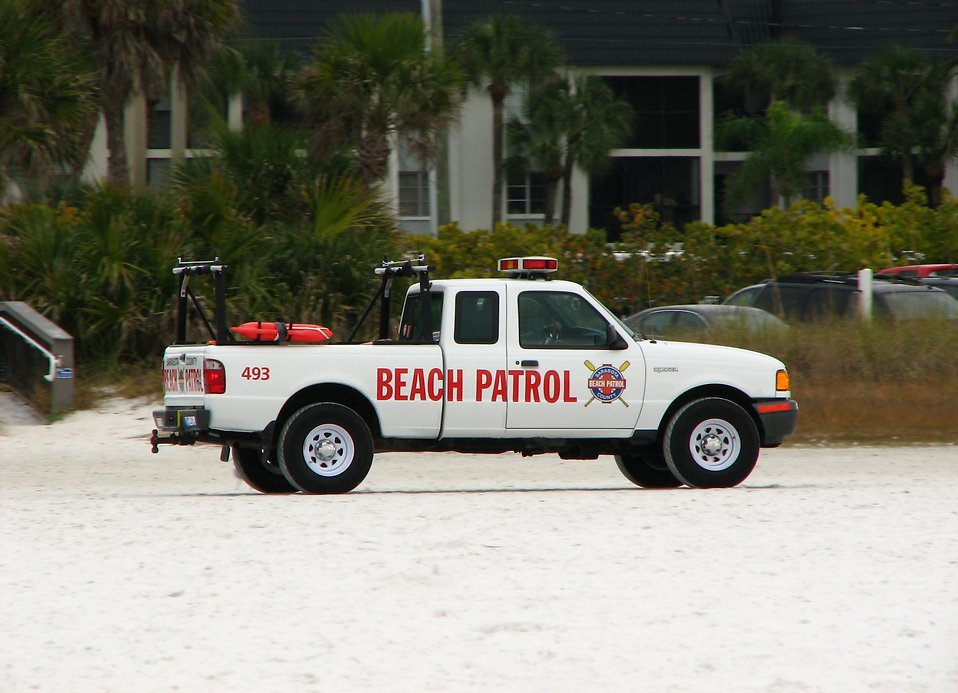 A beach patrol truck on the beach : Free Stock Photo