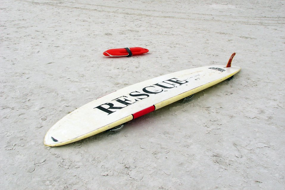 A lifeguard rescue surfboard on the beach : Free Stock Photo