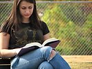 Free Stock Photo: Closeup of teenage girl reading a book
