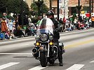 Free Stock Photo: A police officer on a motorycle in the 2010 Saint Patricks Day Parade in Atlanta, Georgia