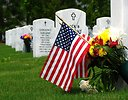 Free Stock Photo: Close-up of gravestones and an American flag at the Georgia National Cemetery