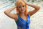 Free Stock Photo: A beautiful young woman posing by a lake
