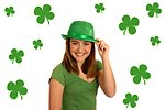 Free Stock Photo: A cute young girl dressed up for Saint Patrick's Day with a green hat surrounded by shamrocks