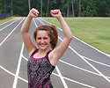 Free Stock Photo: A cute young girl on a track field