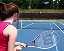 Free Stock Photo: A cute young girl playing tennis