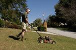 Free Stock Photo: A man mowing a lawn