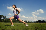Free Stock Photo: A young woman stretching outdoors before exercising