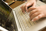 Free Stock Photo: Female hands typing on a laptop keyboard