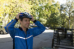 Free Stock Photo: A bicyclist putting on a safety helmet