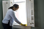 Free Stock Photo: An African-American woman cleaning a window