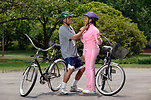 Free Stock Photo: An African-American couple preparing for bike ride
