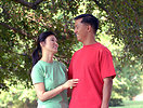 Free Stock Photo: An asian couple smiling at each other outdoors