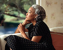 Free Stock Photo: An African-American woman looking out a window