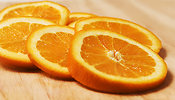 Free Stock Photo: Orange slices on a cutting board