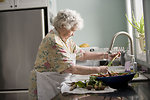Free Stock Photo: An elderly woman washing produce