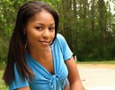 Free Stock Photo: Portrait of a beautiful African American teen girl posing outdoors in the woods