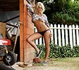 Free Stock Photo: A beautiful blond woman posing by a shed