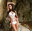 Free Stock Photo: A beautiful brunette in a swimsuit posing on rocks
