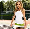 Free Stock Photo: A beautiful blonde at the net on a tennis court
