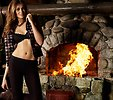 Free Stock Photo: A beautiful woman posing in lingerie by a fireplace