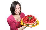 Free Stock Photo: A beautiful woman holding a strawberry cake isolated on a white background