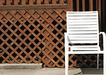 Free Stock Photo: White chair by fence