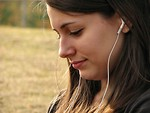 Free Stock Photo: Teenage girl listening to music
