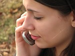 Free Stock Photo: Closeup of teenage girl talking on cell phone