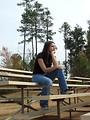 Free Stock Photo: A teenage girl sitting on bleachers