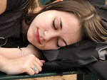 Free Stock Photo: Closeup of a teen girl sleeping on a bench