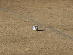 Free Stock Photo: Soccer ball in middle of a field