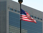 Free Stock Photo: US flag in front of a modern glass building