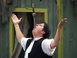 Free Stock Photo: Sword swallower with a sword in his mouth