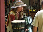 Free Stock Photo: Woman selling drums at festival