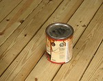 Free Stock Photo: Can of wood stain on wooden deck