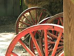 Free Stock Photo: Wooden wheels and hay in old rustic barn