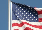Free Stock Photo: Closeup of a US flag flying on a flag pole